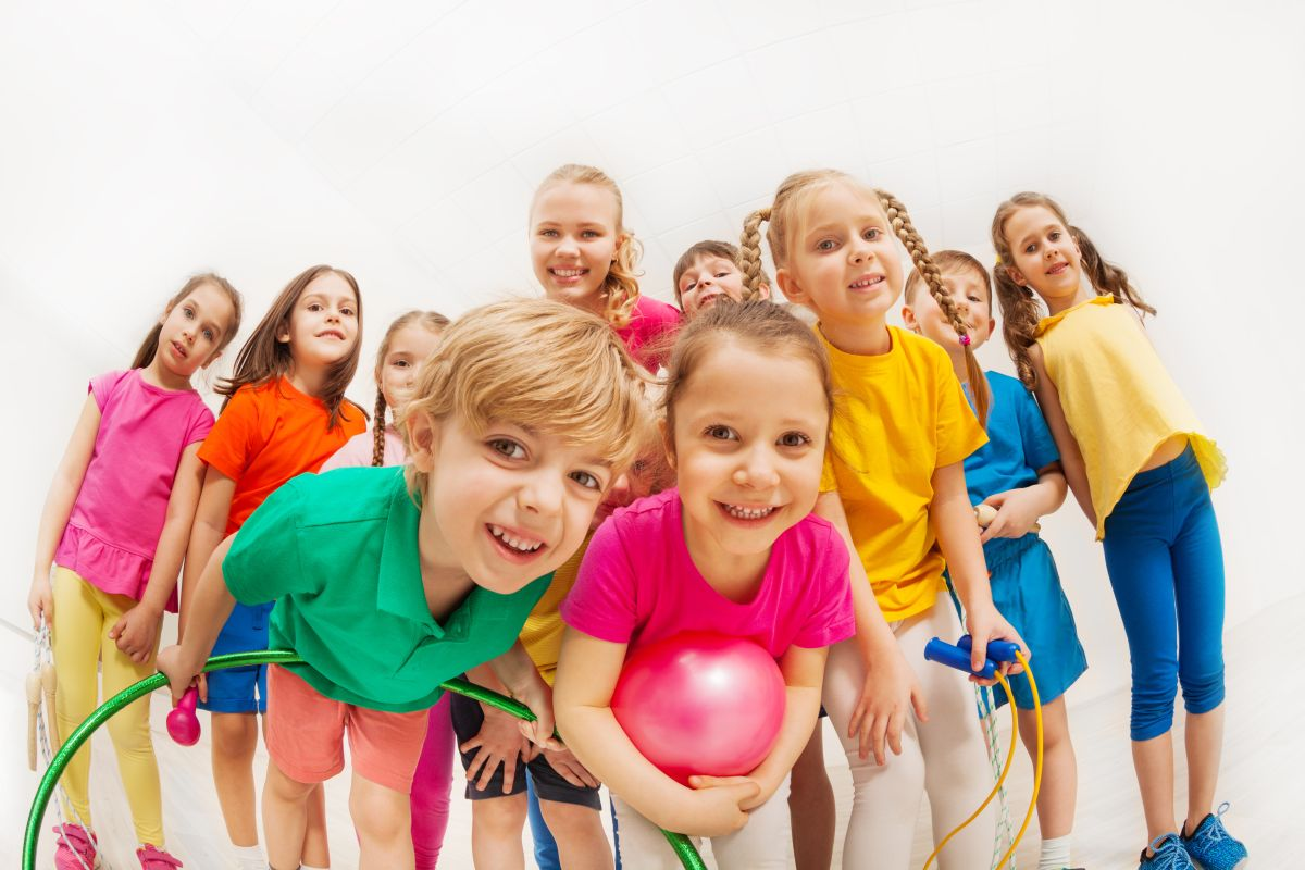 Sporty,Kids,And,Gymnastics,Coach,Having,Fun,In,Gym
